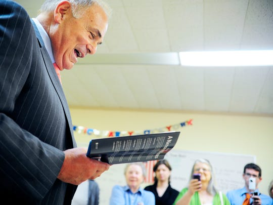 "Former Gov. Ed Rendell reads aloud part of a speech he quoted in his book ""A Nation of Wusses"" to a small crowd at his book-signing on Wednesday, June 13, 2012, at York County's Democratic headquarters. Rendell greeted local Democrats and signed copies of his book."