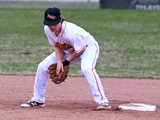 South Gibson's Trey Sherrill fields a ball at second base as a Dyersburg runner approaches during their game in Medina.