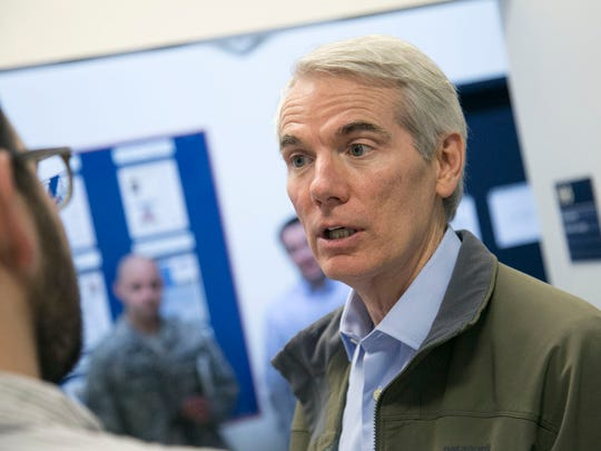 U.S. Sen.Rob Portman talks to members of the press about his visit on Wednesday to the 179th Airlift Wing of the Air National Guard.