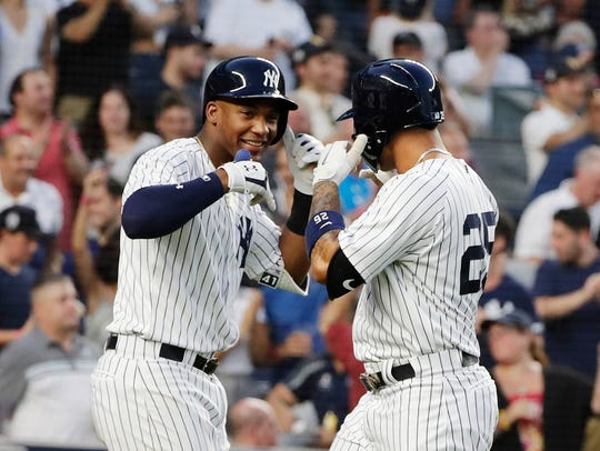 Miguel Andujar, left, celebrates a home run with teammate Gleyber Torres.