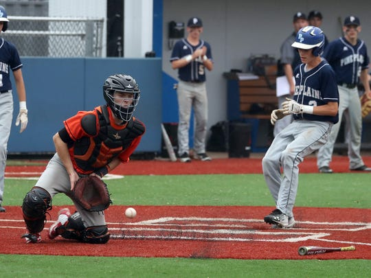 Adam Funk of Pine Plains scores as Tuckahoe catcher Ryan Rockhill takes the late throw in the seventh of a Class C regional semifinal baseball game at Pace University May 31, 2018. Pine Plains defeated Tuckahoe 3-0.