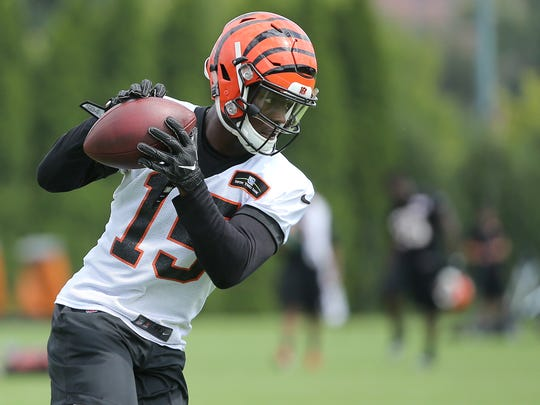 The Enquirer/Kareem Elgazzar Rehabbing Cincinnati Bengals rookie wide receiver John Ross says, ?I think it?s imperative to play in the preseason.? Cincinnati Bengals wide receiver John Ross (15) makes a catch during Cincinnati Bengals training camp practice, Friday, July 28, 2017, on the practice fields next to Paul Brown Stadium in Cincinnati.