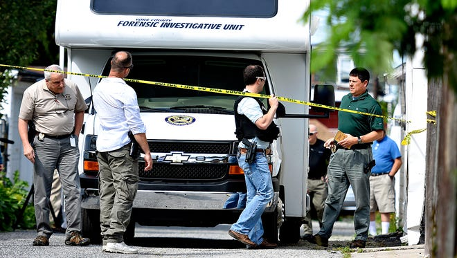 A mobile forensics unit arrives on scene as officials investigate a shooting at 974 East Philadelphia Street in York City, Thursday, June 9, 2016. York City Police Chief Wes Kahley said that a Sheriff's deputy, who was serving a warrant at the address, was shot in the face by the suspect, who was then also shot.  Dawn J. Sagert photo