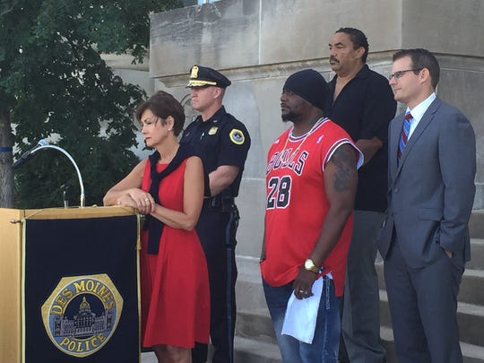 From left, Gov. Kim Reynolds, Des Moines Police Chief