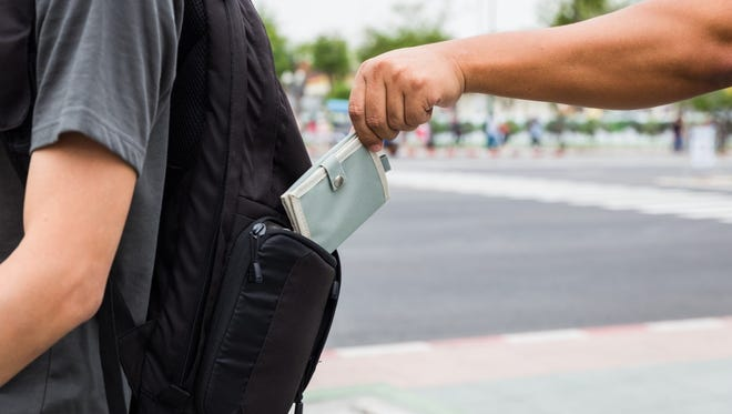 Follow a few simple preventative measures to avoid becoming a victim of tourist theft while on a summer vacation.