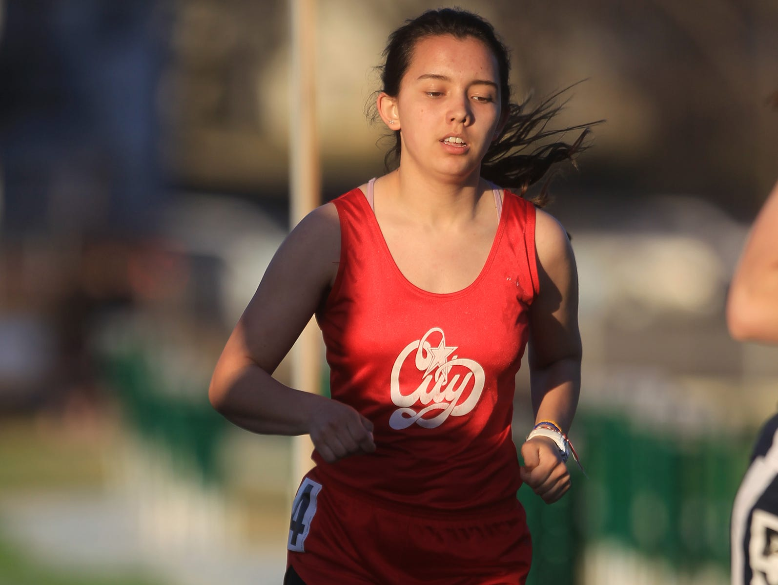 City High's Celeste Chadwick competes in the 800 meter run at the Women of Troy Relays at West High on Tuesday, March 31, 2015. David Scrivner / Iowa City Press-Citizen