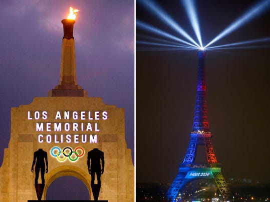 FILE - At left is a Feb. 13, 2008, file photo showing the facade of Los Angeles Memorial Coliseum in Los Angeles. At right, in a Feb. 3, 2017, file photo, the Eiffel Tower is lit with colors for Paris 2024 during the launch of the international campaign of Paris as candidate for the 2024 Olympic summer games in Paris. Officially, Los Angeles and Paris are the only two bidders left for the 2024 Games that will be awarded in September at a meeting of Olympic leaders in Lima, Peru. On the table, however, is a proposal to use that meeting to dole out the next two Olympics _ 2024 and 2028 _ one to each city. (AP Photo/File)