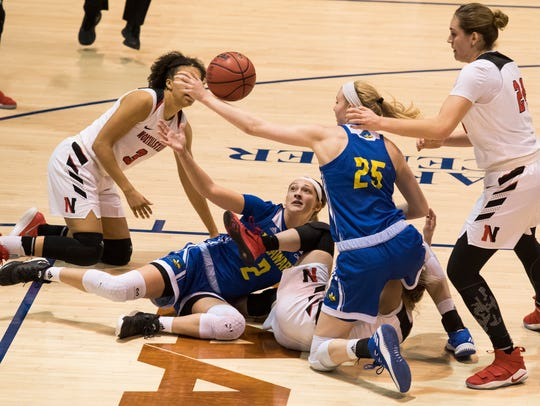 Delaware's Abby Gonzales (2) and Rebecca Lawrence (25)