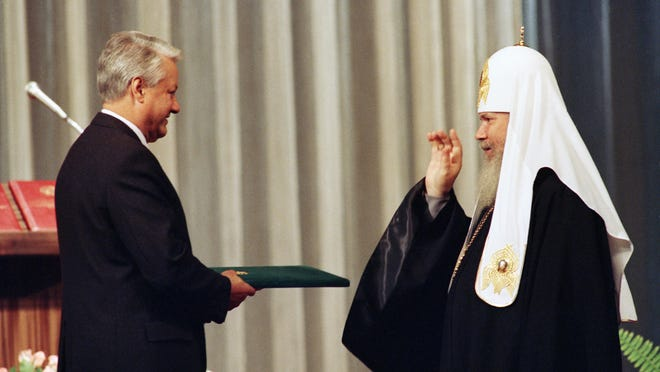 Patriarch Alexi II of All Russia Orthodox Church bestows a blessing on Boris Yeltsin, after Yeltsin's inauguration at the Kremlin in Moscow on July 10, 1991, as the first popularly-elected President of the Russian Republic.