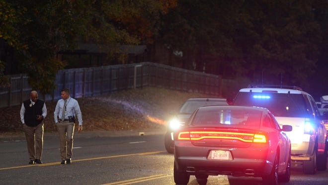Jackson police investigate the scene near the intersection of Campbell Street and North Parkway where an officer was stabbed Thursday. Police said the officer fatally shot the man who stabbed him. The officer was released from the hospital.