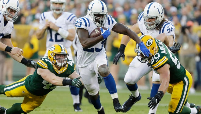Indianapolis Colts running back Frank Gore (23) evades Green Bay Packers inside linebacker Blake Martinez (50) and inside linebacker Jake Ryan (47) in the second quarter at Lambeau Field.