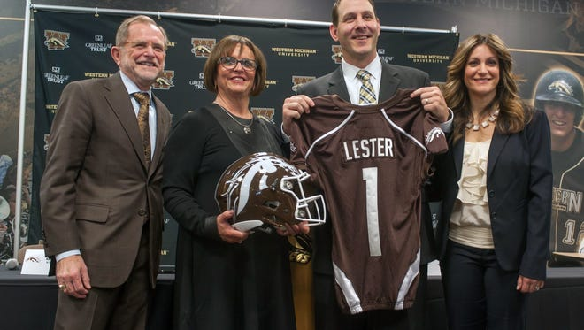From left, WMU President Dr. John Nunn, WMU AD Kathy Beauregard, football coach Tim Lester and his wife, Dawn Lester, pose for photographs after being introduced as the new WMU football coach Saturday afternoon.