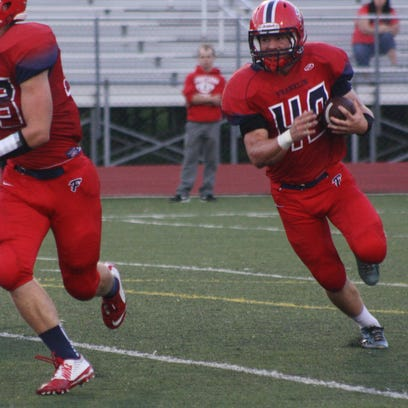 Churchill junior quarterback Evan Cummins has emerged as a running and passing threat for the Chargers.