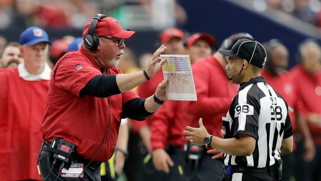 Arizona Cardinals head coach Bruce Arians, left, argues a call during the first half of an NFL football game against the Houston Texans, Sunday, Nov. 19, 2017, in Houston.