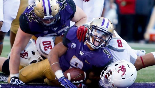 Nov 27, 2015; Seattle, WA, USA; Washington  running back Myles Gaskin (9) rushed for 1,302 yards and 14 TDs last season.