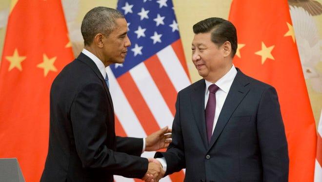 President Obama greets President Xi Jinping in Beijing on Nov. 12, 2014.