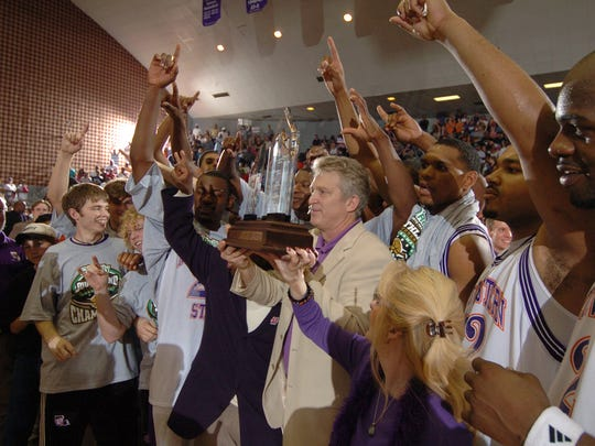 Head coach Mike McConathy (center) and his Northwestern State Demons celebrate after earning an NCAA Tournament spot by defeating Sam Houston State in the 2006 Southland Conference Tournament final.