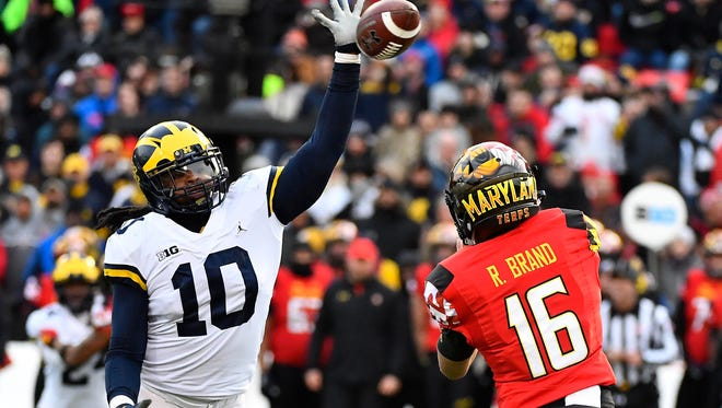 Devin Bush deflects a pass attempt by Maryland's Ryan Brand in the first half Nov. 11.