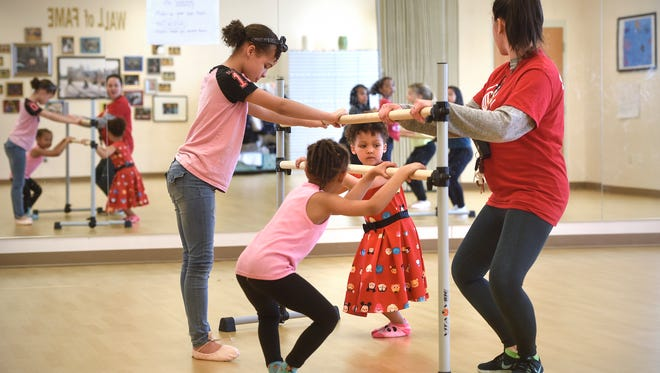Instructor Natalie Carr leads students through a dance exercise in preparation for the upcoming showcase performance Thursday, May 3, at the Eastside Boys & Girls Club in St. Cloud.