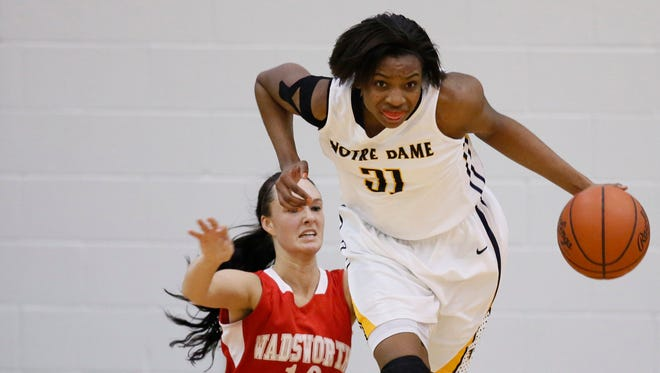 Notre Dame's Tierra Floyd (31) steals the ball from  Wadsworth's Taylor Wyatt (10) during the Division I girls basketball regional final.