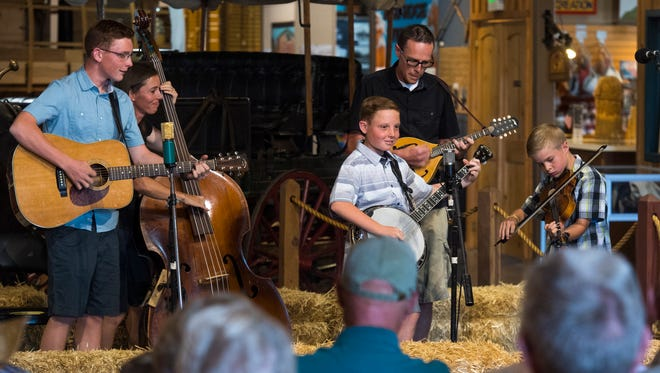 The Washburn Family Bluegrass band perform for guests at the Frontier Folk Festival in Frontier Homestead State Park Friday, June 22, 2018.