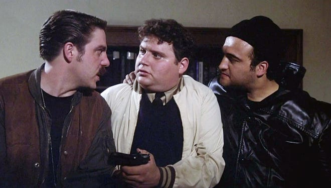 """Bruce McGill (from left), Stephen Furst and John Belushi in a scene from the 1978 comedy """"National Lampoon's Animal House."""""""