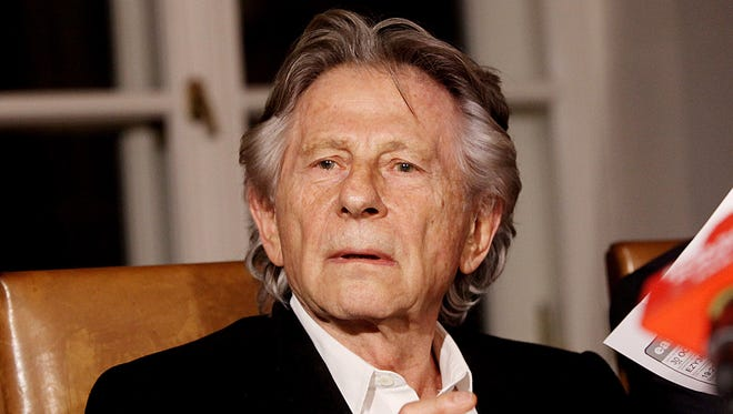 """FILE - In this Oct. 30, 2015 file photo filmmaker Roman Polanski tells reporters he can """"breath with relief"""" after a Polish judge ruled that the law forbids his extradition to the U.S., where in 1977 he pleaded guilty to having sex with a minor, in Krakow, Poland. Poland will not extradite Oscar-winning filmmaker Roman Polanski to the U.S. in an almost 40-year-old case after prosecutors declined to challenge a court ruling against it. Prosecutors in Krakow, who sought the extradition on behalf of the U.S., said Friday they found the court's refusal of extradition to be """"right"""" and said they found no grounds to appeal it. (AP Photo/Jarek Praszkiewicz, file)"""