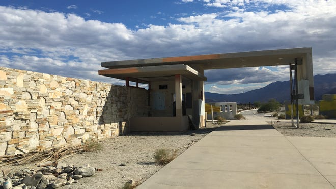 The abandoned and unfinished entrance to the Avalon real estate development on the northern edge of Palm Springs. New developers are proposing a new project on this land, replacing an 18-hole golf course with olive groves.