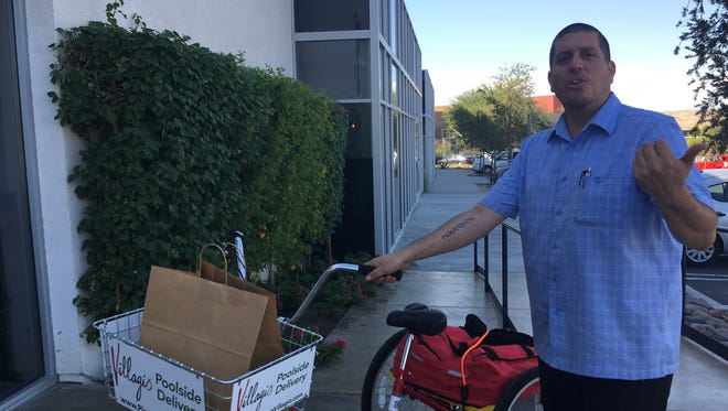 Paul Vega, opeartor of Villagio Italian Kitchen  in Palm Desert, has bicycle delivery to area hotels.