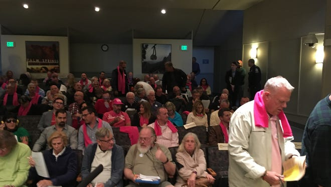 Overflow crowds filled Palm Springs City Hall on Wednesday as the City Council approved sweeping new rules regulation vacation rentals. Supporters of the industry donned pink scarfs to show their solidarity.