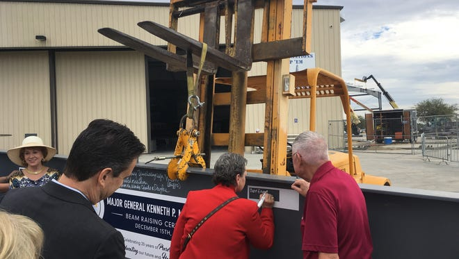 A massive I-Beam which will become part of the new Kenneth P. Miles Korean and Vietnam War Hangar at the Palm Springs Air Museum, was signed Thursday, Dec. 15, 2016  by museum supporters.