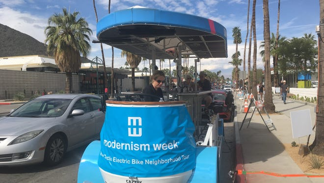 The Sunny Cycle tours of downtown Palm Springs during Modernism Week place place up to 15 people on this vehicle for 90 minutes pedaling fun.