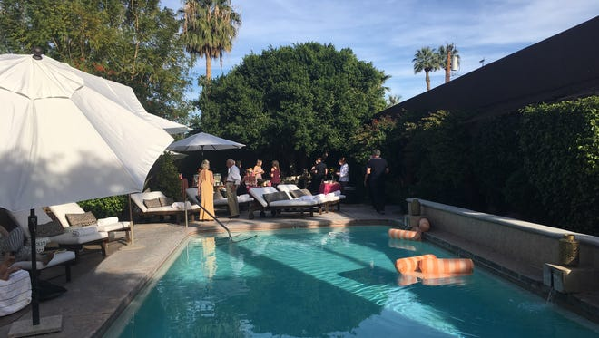 Guests mingle at The Rossi Hotel in Palm Springs. The tiny eight-room property was formerly The San Giuliano