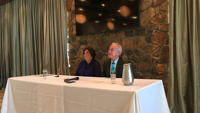 From left, Palm Springs City Council candidates Judy Deertrack and Robert Stone, held a press conference Thursday at the Escena Club House to describe their efforts to aid the Riverside County District Attorney's public corruption investigation into former Mayor Steve Pougnet and fellow developers Richard Meaney and John Wessman.