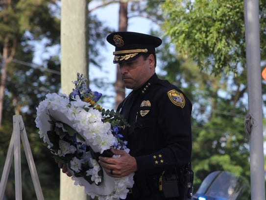 Tallahassee Police Chief Michael DeLeo with a wreath