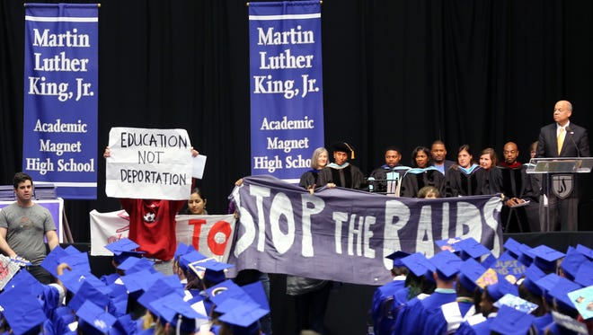 Jeh Johnson, Secretary of Homeland Security, pauses as his commencement speech is interupted by protesters at the MLK High School graduation ceremony held Saturday May 14, 2016 at Lipscomb's Allen Arena.