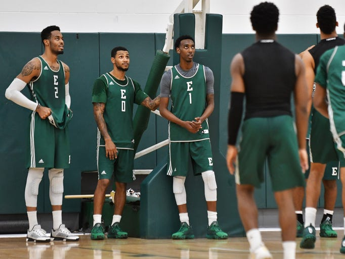 From left, Eastern Michigan basketball players James
