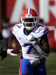 Florida's Duke Dawson (7) takes his interception into the end zone during the first half of an NCAA college football game against Arkansas Saturday, Nov. 5, 2016, in Fayetteville, Ark. (AP Photo/Samantha Baker)