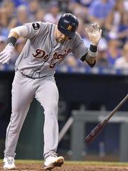 Tigers third baseman Castellanos flips his bat to the