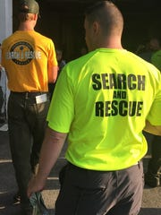 Searchers gather Wednesday for a briefing before resuming