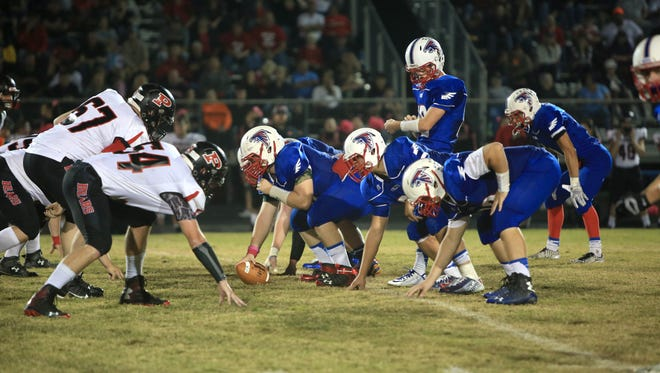 West Henderson's football team went 8-5 in 2014, a year after a 1-10 season.
