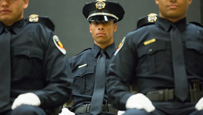 Las Cruces  police cadet Justin Phillips, center, looks on during the Las Cruces Police Departments 45th Police Academy graduation ceremony on Friday, March 18, 2016, at Doña Ana Community College. There were 10 police cadets and one firefighter who graduated from the state-certified law enforcement training academy.