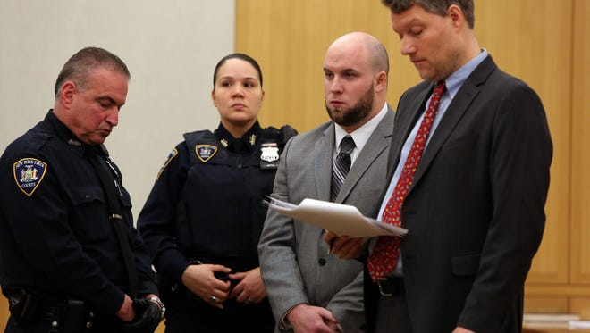 Ex-NYPD Officer Brendan Cronin stands with his lawyer Pierre Sussman, right, during sentencing to nine years in prison for a drunken spree in Pelham, April 13, 2016 at Westchester County Courthouse in White Plains. Cronin fired at least 14 bullets towards two New Rochelle men who were driving home from a recreational hockey game, injuring one of them.