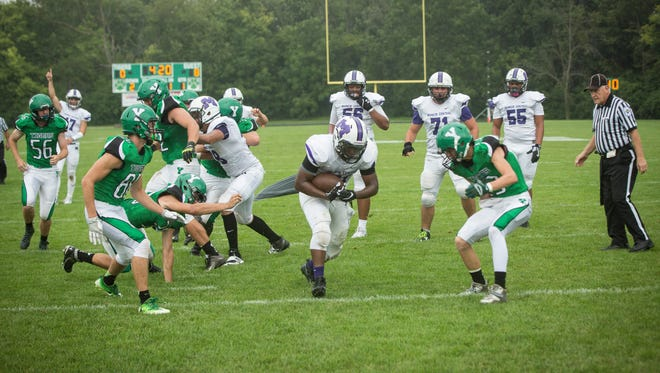 Central's Xavier Cleaves runs for a touchdown Saturday afternoon during a postponed game. The Bearcats won 28-21.