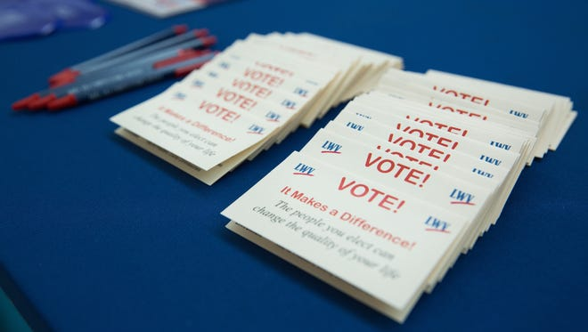 Voting cards are ready to be distributed at a voter registration event Tuesday, Sept. 26, at Centennial High School.