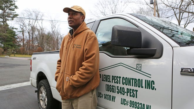 Claude Maxwell, president of Top Level Pest Control, outside a client's house in White Plains, Dec. 28, 2016.