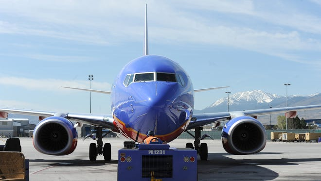 A Southwest Airlines plane is pushed into the runway at Reno Tahoe International Airport April 9, 2014.