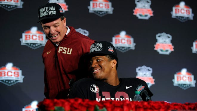 Florida State coach Jimbo Fisher and quarterback Jameis Winston at a news conference following their victory over Auburn for the 2013 BCS national championship.