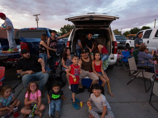 The Monsivaiz family waits along South Solano Drive for the 2018 Electric Light Parade to start, Tuesday July 3, 2018.