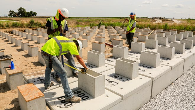 Urn vaults are built at the national cemetery in Omaha, Neb., Wednesday, July 27, 2016. The long-awaited Omaha national cemetery for U.S. military veterans and their families will be dedicated Friday, Aug. 5 before accepting its first burials this fall.